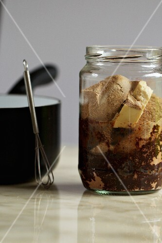 A jar of ingredients for vegan chocolate