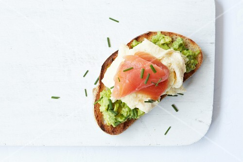 Sour dough bread with avocado cream, scrambled egg and smoked salmon