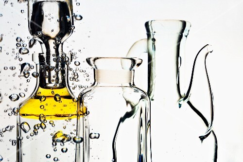 Droplets of olive oil and oil carafes