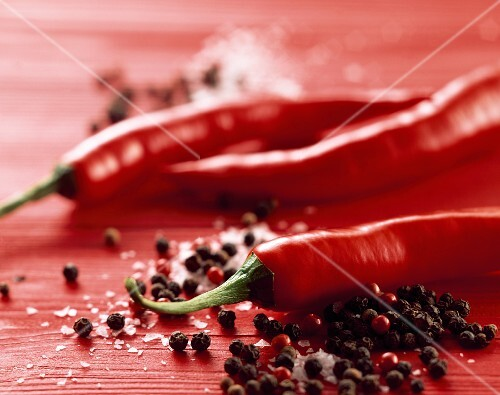 Chilli peppers, salt and peppercorns