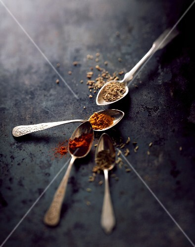Oriental spices on four spoons