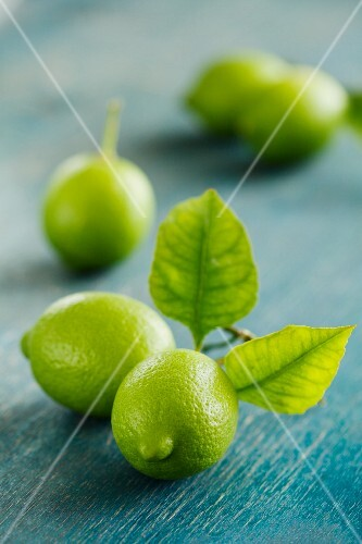 Limes on a rustic surface