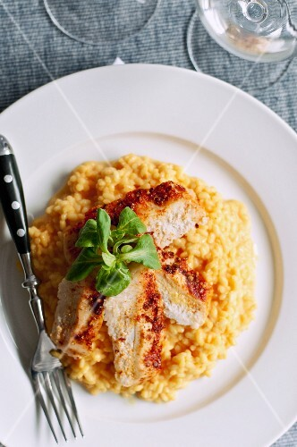 Saffron risotto with chicken and lamb's lettuce