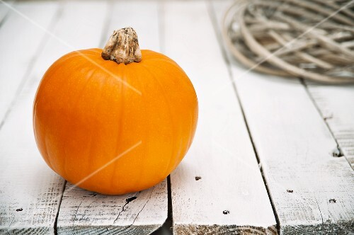 A pumpkin on a wooden table