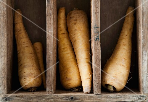 Parsnips in a wooden crate