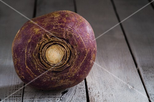 A turnip on a wooden surface
