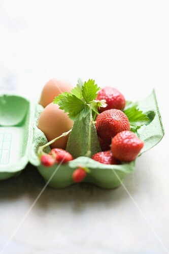 Strawberries and eggs in an eggbox