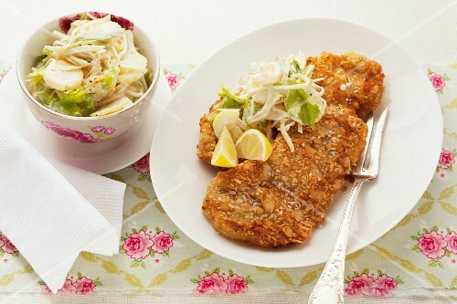 Schnitzel with almond breadcrumbs and a side salad