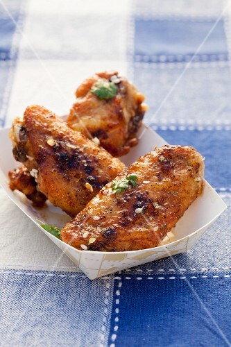 Sesame Lime Chicken Wings in a Cardboard Container