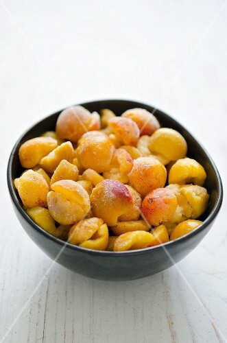 Frozen mirabelle plums in a bowl
