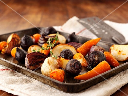 Roasted onions, carrots and beetroot on a baking tray
