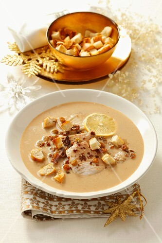 Carp soup with raisins, plum jam and croutons (Christmassy)