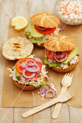 Home-made burgers with surimi salad, tomato, lettuce and red onion