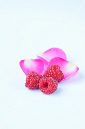 Raspberries with pink rose petals