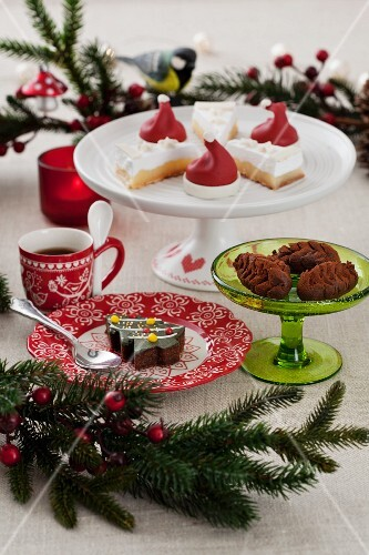 An assortment of baked Christmas goods and a cup of coffee