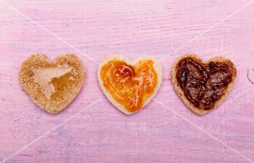 Hearts cut out of bread, with jam and honey, for Valentine's Day