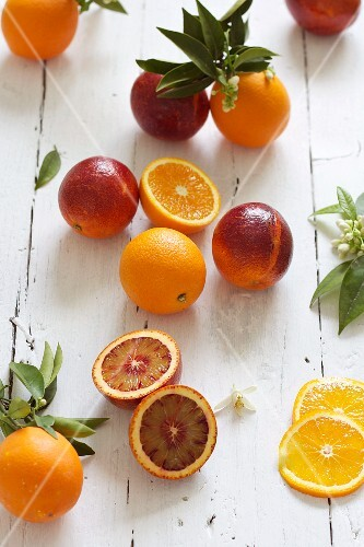 Oranges and blood oranges with leaves