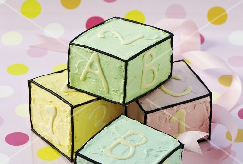 Dice-shaped cakes with liquorice edging, letters and numbers