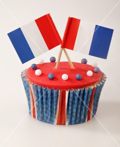 A cupcake decorated with French flags