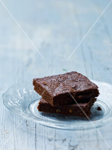Two brownies on a glass plate