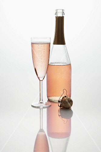 Pink sparkling wine (bottle, champagne glass and cork)