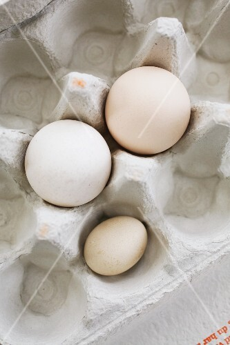 Three eggs in an egg box