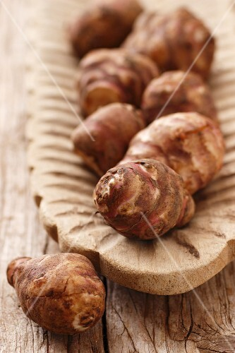 Jerusalem artichokes in a wooden bowl