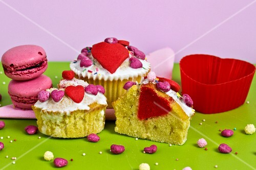 Heart-shaped cupcakes and strawberry macaroons