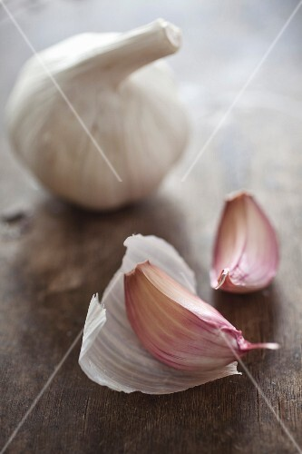 A whole bulb of garlic and two cloves of garlic
