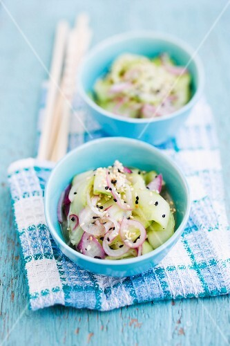 Cucumber salad with red onions and sesame seeds (Asia)