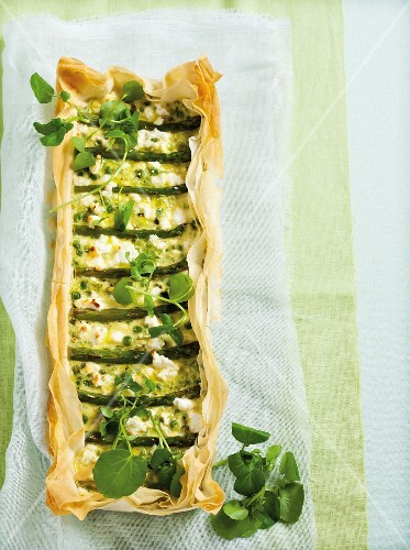 Filo pastry tart with peas, green asparagus and watercress