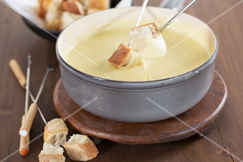 Cheese fondue with cubes of white bread