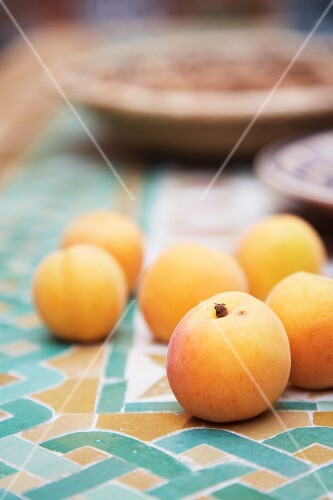 Apricots on mosaic tiles