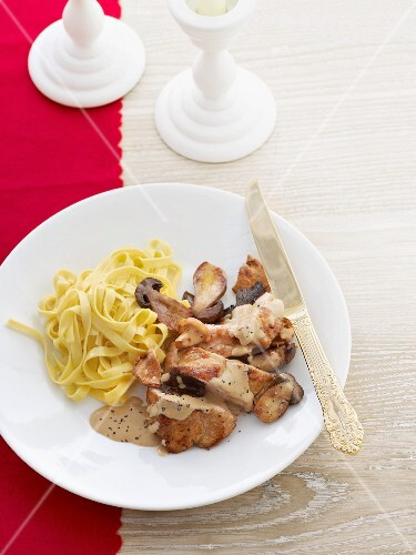Veal schnitzel with mushroom sauce and ribbon pasta