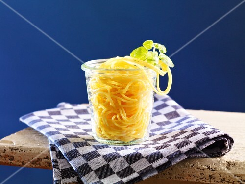 Cooked spaghetti in a glass container