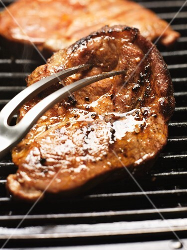 Barbecued pork steak on the barbecue
