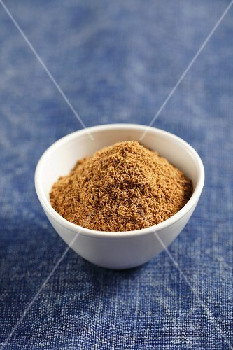 A small bowl of ground cumin