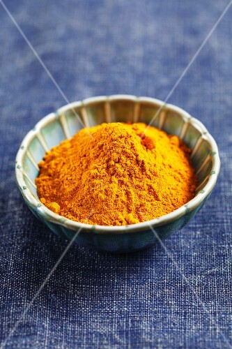 Ground turmeric in a small bowl