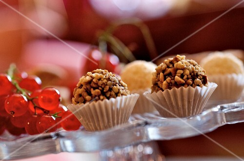Filled chocolates covered with chopped nuts