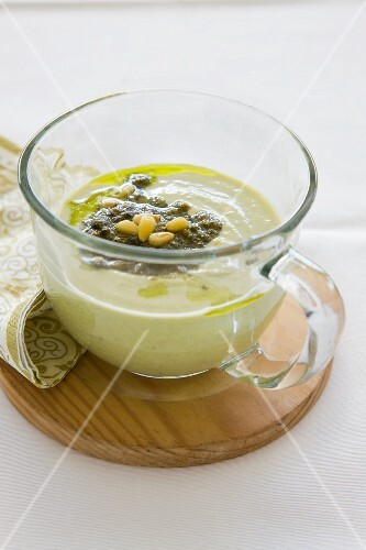 Cream of asparagus with pesto and pine nuts
