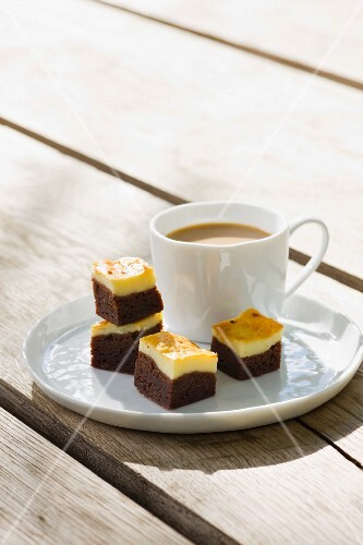 Cheesecake brownies with a cup of coffee