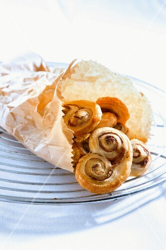 Puff pastry 'pig's ears' in a paper bag