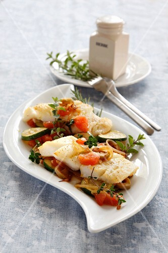 Halibut with tomatoes and courgettes
