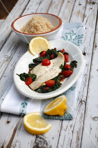 Zander fillet with cherry tomatoes on a bed of spinach
