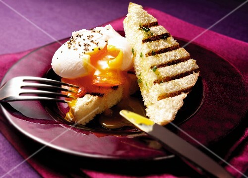 Triangles of toast with a poached egg