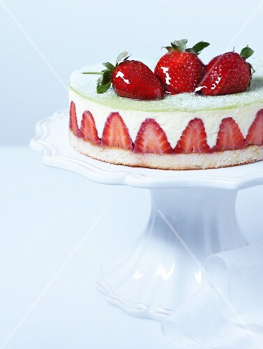 Cheesecake with strawberries on a torte stand