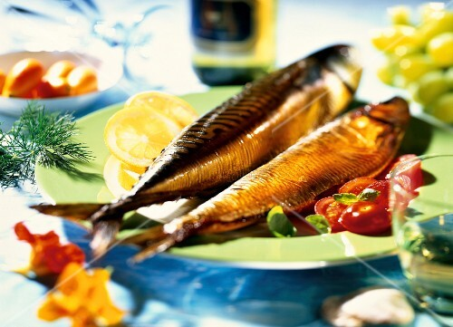 Smoked fish with tomatoes and lemon