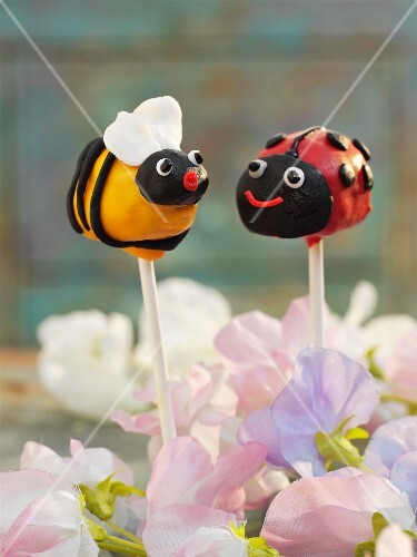 Cake pops decorated to look like a bee and a ladybird