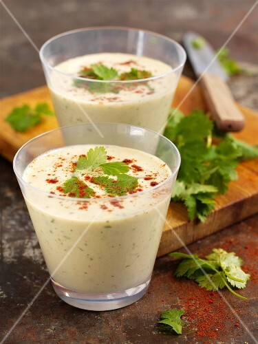 Avocado and cucumber smoothies with peanuts and coriander leaves