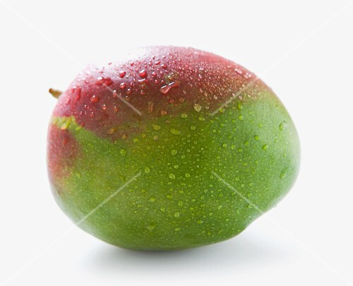 A mango with drops of water